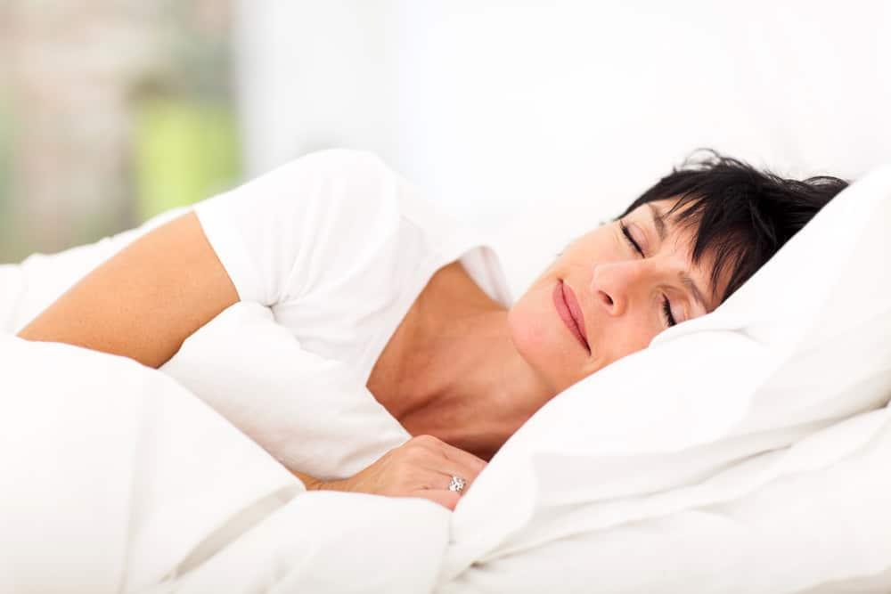 women sleeping on bed