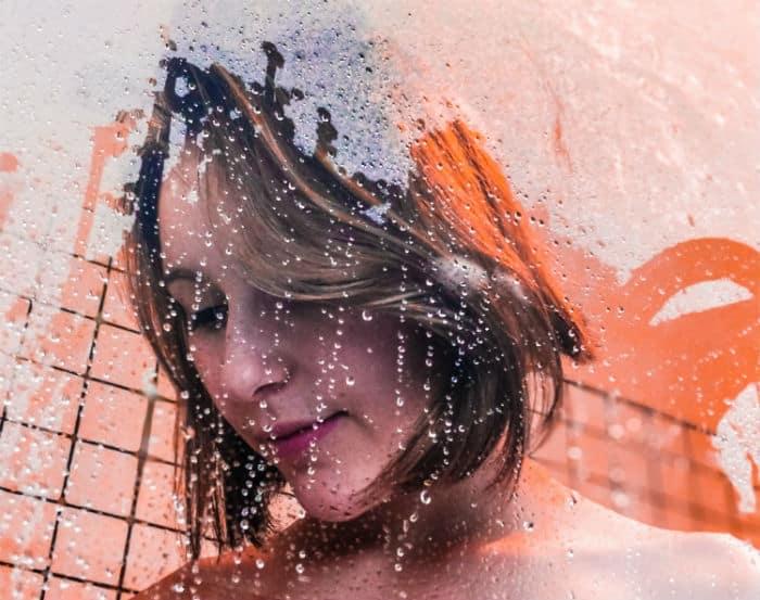women taking cold shower