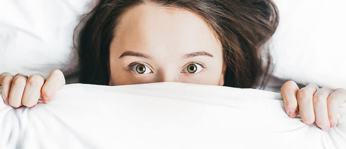 woman lying on bed sleepless night