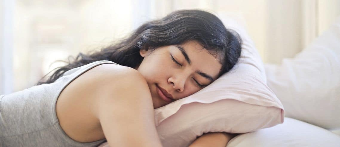 woman-in-grey-tank-sleeping-with-pillow