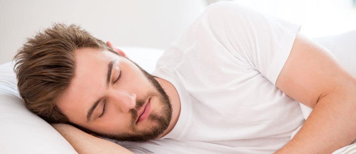 man-sleeping-in-comfortable-bed