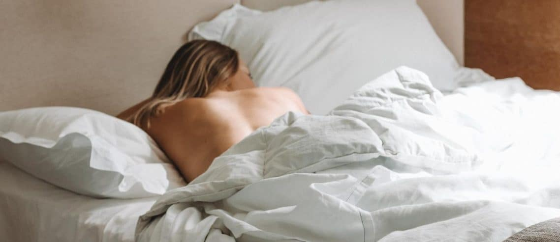 woman-sleeping-in-white-comfy-bed