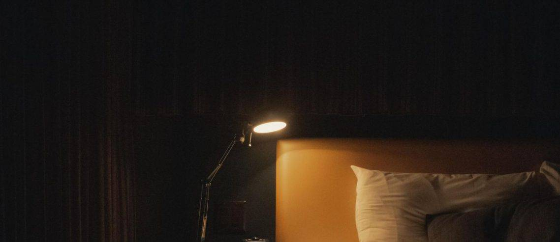 study-with-lamp-beside-bed