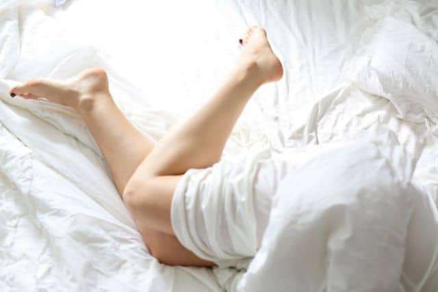 legs-wrapped-in-white-sheets