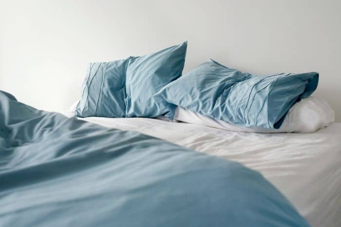 comfy-grey-and-white-pillows-on-bed