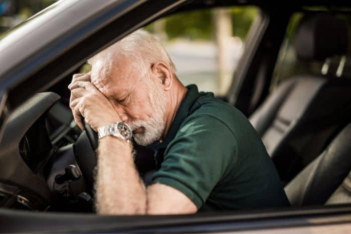man-falling-asleep-on-the-wheel-while-driving